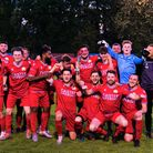 """Caister FC players celebrate winning Football team wearing new shirts dedicated to """"The Nine."""""""