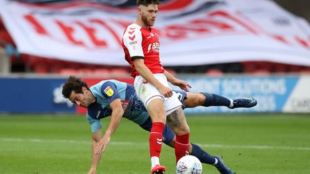 Fleetwood Town's Wes Burns (front) and Wycombe Wanderers' Joe Jacobson battle for the ball during th