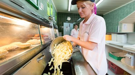 Vicky Garvin putting chips in the fryer at the Seahorse fish and chip shop in Dagenham.