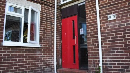 One of the main doors to flats with no security locks in place. Picture: DENISE BRADLEY
