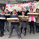 Smiles all round as pupils at Blue Gate Fields Infants inShadwellget theirfree laptops
