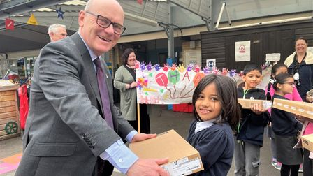 Blue Gate Field's seven-year-old pupil Mariam gets her own laptop frommayor John Biggs