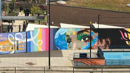 School wall in Bow with a splash of colour and a message to the UN to 'save the planet'