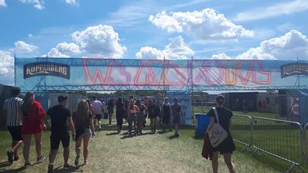 Frustrated festival goers have complained following reports of stampedes and three hour long queues