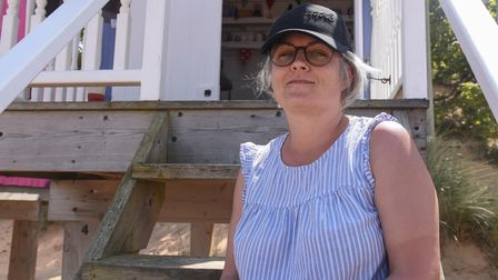 Ms Teresa Felstead, 47, from Little Snoring enjoying one of the beach huts at Wells. Picture: Daniel