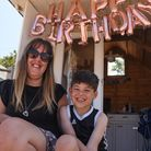 Mrs Danielle Eaves, 38, from Lincolnshire enjoying one of the beach huts at Wells. Picture: Danielle