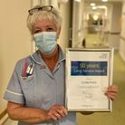 Linda Potts with her long service award after celebrating 50 years at West Suffolk Hospital