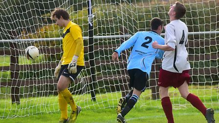 Anglian Combination Division One action between Bungay Town (blue) and Hempnall.