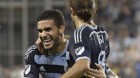 Dom Dwyer celebrates another happy sporting Kansas City moment with Graham Zusi. Picture: MIKE GUNNO