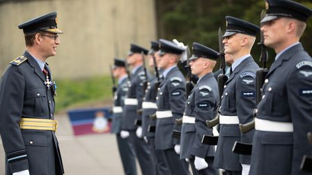 Pictured: Air Officer Commanding 2 Group, Air-Vice Marshal Al Gillespie (left) speaks to Trainee Gun