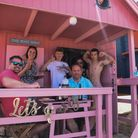 Holidaymakers enjoying one of the beach huts at Wells beach. Picture: Danielle Boode