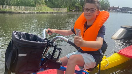 Theo Dought tries out Buoyancy Bikes in Wroxham.