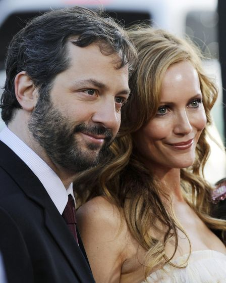"""Leslie Mann, right, a cast member in the film """"17 Again,"""" poses with her husband, writer/director Ju"""