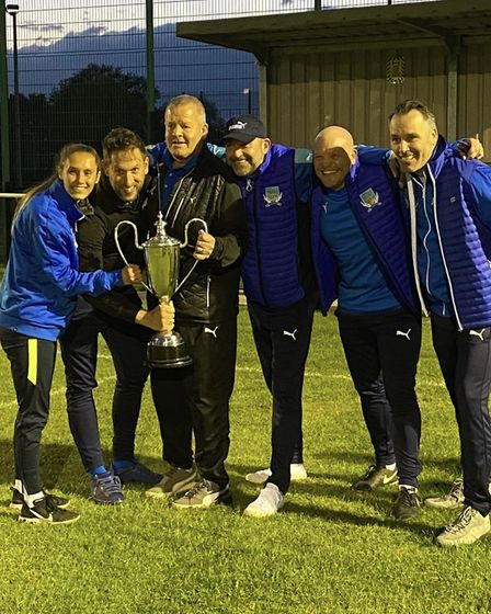 Dunmow Town's management team celebrate with the COVID Cup