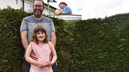 Stephen and Florence Seargeant with the scarecrow they created for the Bredfield scarecrow trail