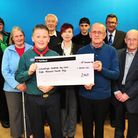 Presentation of funds raised from Christmas Day swim on Lowestoft beach to local charities.