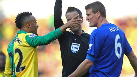 Robert Huth of Leicester City gets a yellow card from referee Mark Clattenburg. Picture: PAUL CHESTE