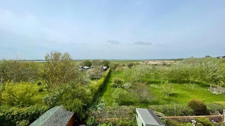 The property boasts views across the sea, beach and marshes