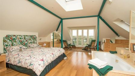 The master suite at the top of the property