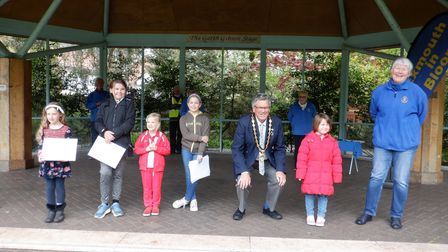 The mayor is pictured with some of the young prize winners