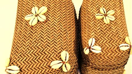 Two rattan and cowrie shell baskets.
