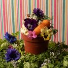 Carrot cake ice cream served in a flower pot with flowers