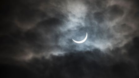 A view of the solar eclipse through the clouds in King's Lynn. PictureL Matthew Usher.