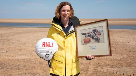 Mandy Humphreys with one of Campbells photographs. Picture: Sarah Lucy Brown