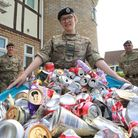 Cpl Samantha Bowler-Legate with the cans she has collected