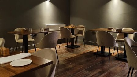 The 'moody' dining area at Kintsu Colchester