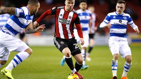 Sheffield United's Lee Evans battles for the ball with Queens Park Rangers' Josh Scowen during the S