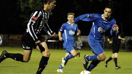 Dereham's Rhys Logan, left, was the star of his side's 2-0 derby win at Wroxham last month. Picture: