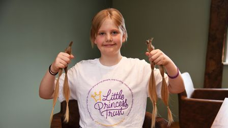 Tyler Beresford aged 11, with the hair he had cut off for the Little Princess Trust