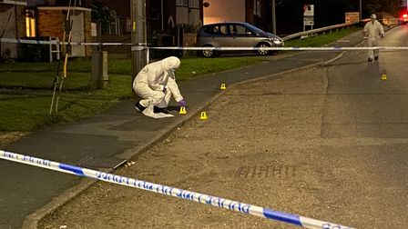 CSI officers worked late into the night at the scene of the attack