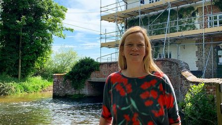 Siobhan Peyton in front of The Sculthorpe Mill, on the River Wensum.