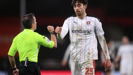 Referee Keith Stroud bumps fists with Rotherham United's Matt Crooks after the Sky Bet Championship