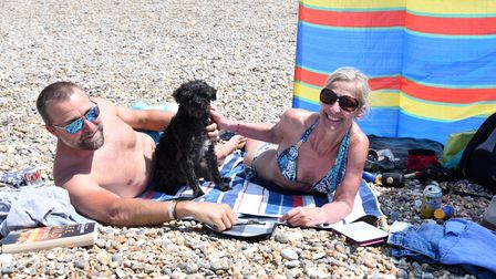 Gary and Alison Miller with Bob the dog. Aldeburgh hot weather Picture: CHARLOTTE BOND