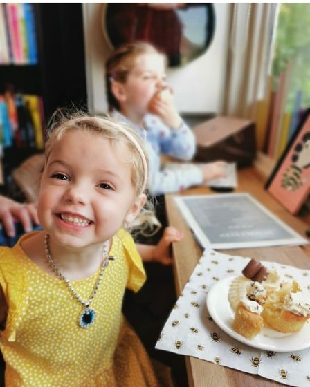 A young customer enjoying some cake at Rumblees in Felsted