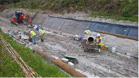 men in hi vis working on reopening wendover arm canal