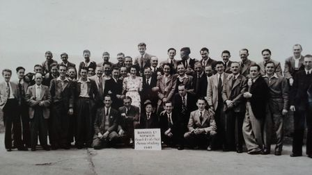 A large group of Barnards Coach Works employees pose for a picture