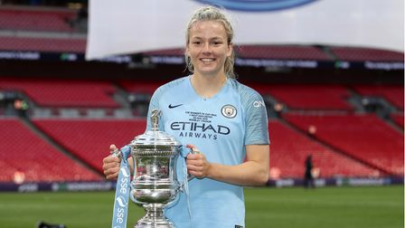 Manchester City Women's Lauren Hemp celebrates with the trophy after the Women's FA Cup Final at Wem