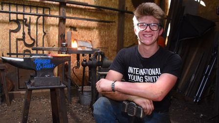 Blacksmith, Alec Steele, 18, who is used to dealing with the heat on the inside of his workshop, but