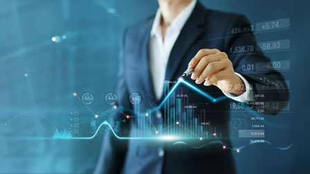 Businessman draw growth graph and progress of business and analyzing financial and investment data ,