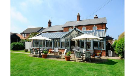 EDP Norfolk Magazine. Titchwell Manor for Dining with David food feature. Outside of the main restau