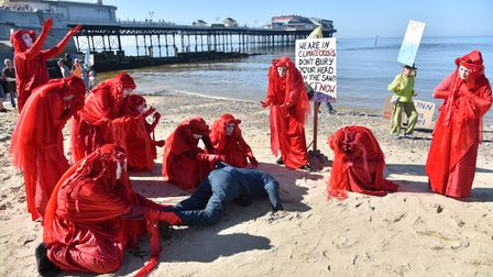 An XR protest in Cromer featuring the Red Rebels. The protest is part of nationwide action ahead of