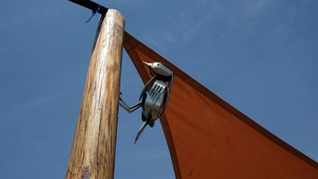 A bird sculpture on the glamping site