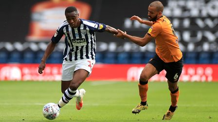 West Bromwich Albion's Rekeem Harper (left) and Hull City's Kevin Stewart battle for the ball during