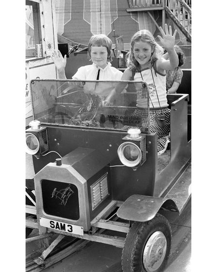 Two youngsters having a great time in a fun car at the museum fair in 1979
