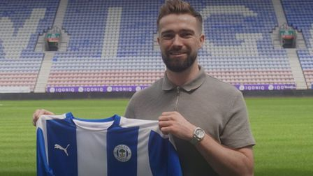 Gwion Edwards has joined Wigan Athletic after leaving Ipswich Town