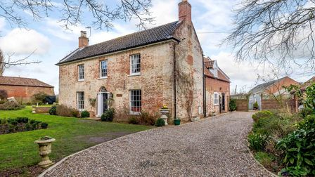 Fine period home set back from the road with lawns at the front and a shingle driveway
